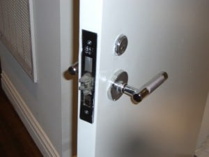 Locking mechanism and handle of a fireproof door