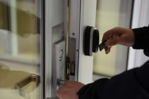 Person gaining access to locked door with a proximity reader device and lock
