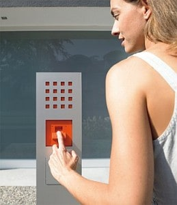 Person with finger on Biometric Access control panel