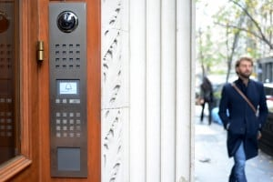 Siedle Intercom installed on an exterior door with passersby