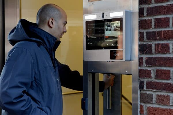 Man looking at a Video security system