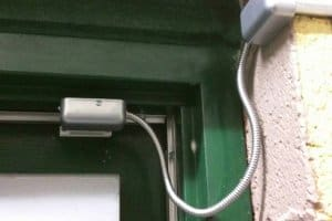 Alarm sensor installed on door frame