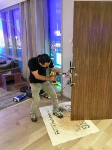 Paragon installer prepping door for lock installation