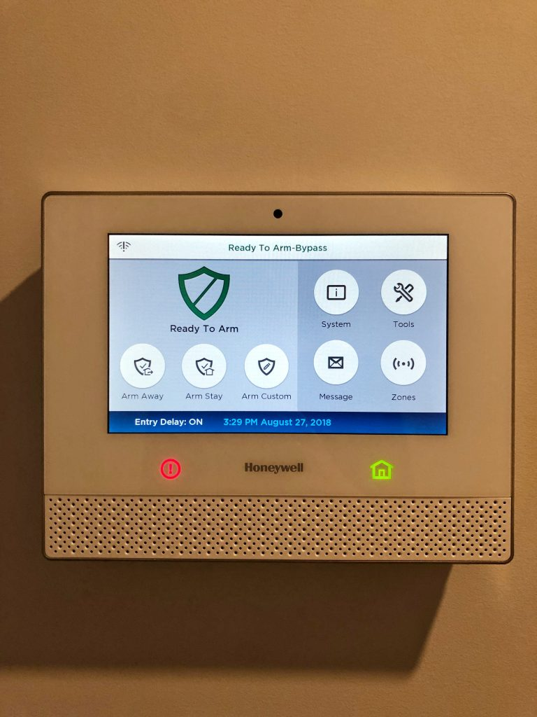 View of Honeywell residential security alarm panel