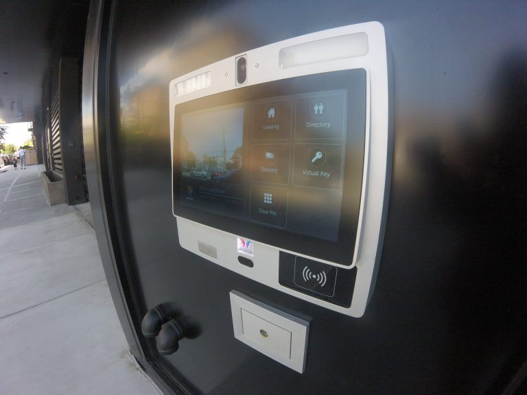 "Side view of ButterflyMX 12"" touch screen entry panel"