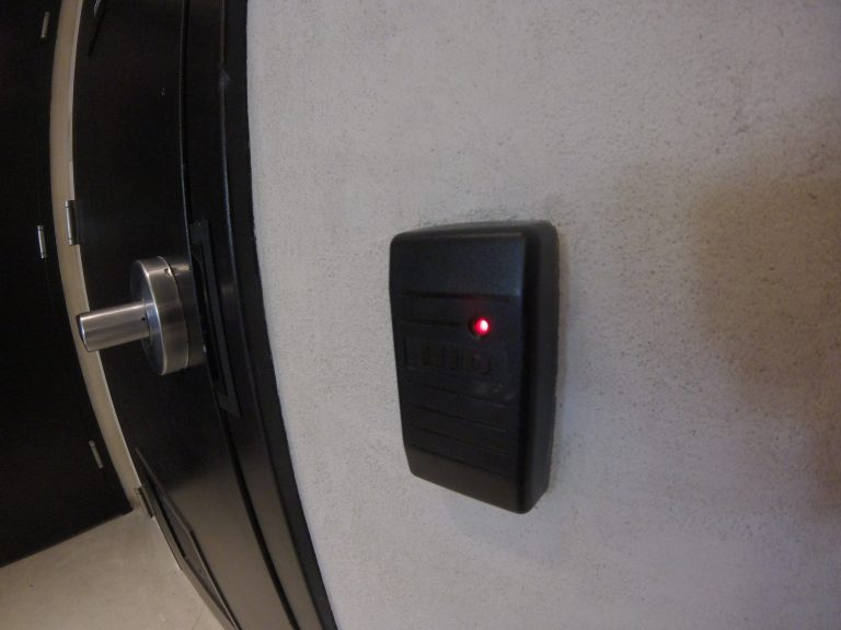 Close up view of a Card reader installed to the right of an interior door