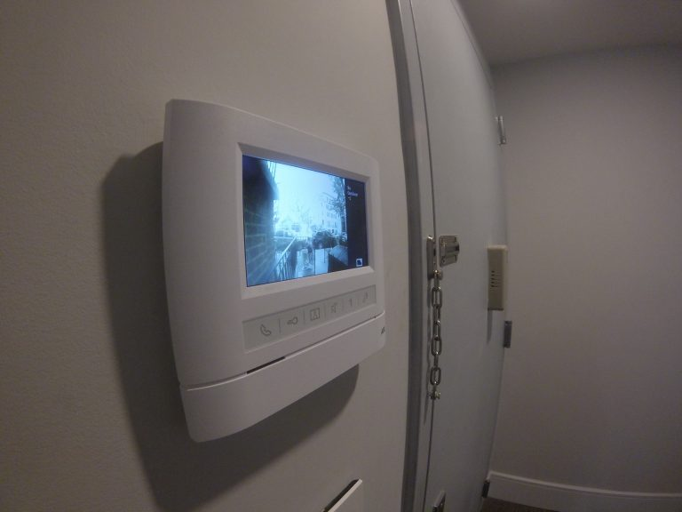 Side view of Front view of an apartment hands free station with 4.3″ video monitor showing the exterior view on the screen