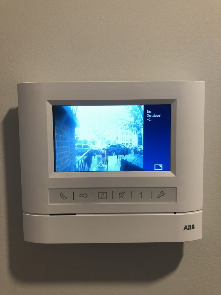 Front view of an apartment hands free station with 4.3″ video monitor showing the exterior view on the screen