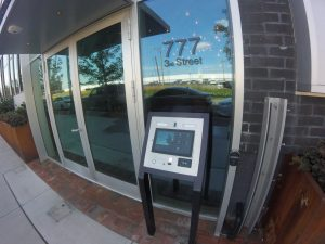 Intercom panel and Smartair Wireless Card Reader shown installed to the right of a residential building entryway
