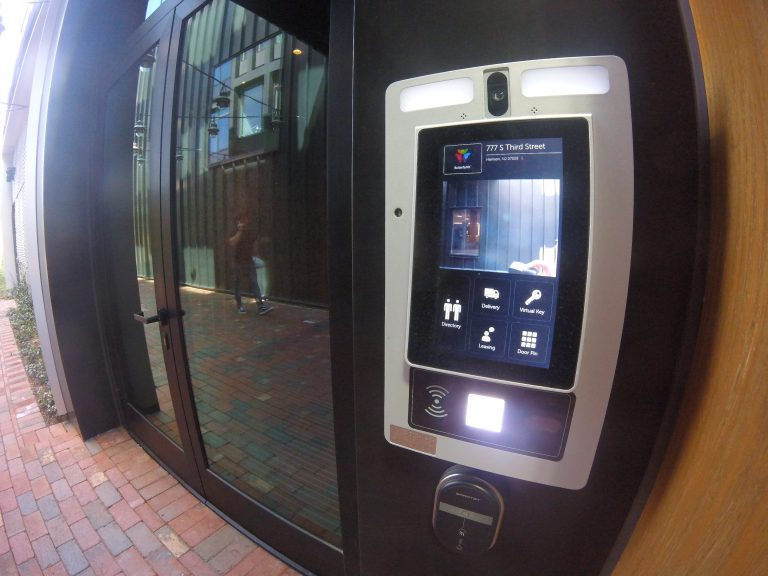 ButterflyMX Intercom System touch panel shown installed on an exterior door