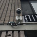 Close up view of Security Camera installed on an exterior concrete wall