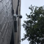 Security Camera installed on exterior wall, seen from below