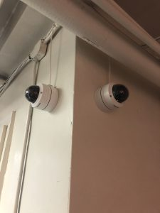 2 Network dome cameras installed on either side of a building corner.