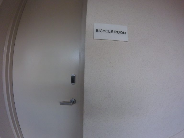 Residential bike room door shown with proximity reader