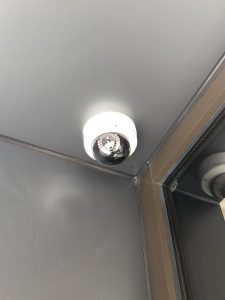 Security dome camera shown installed on an interior ceiling in a corner