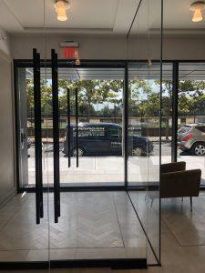 Paragon's installation van seen from inside a set of glass doors