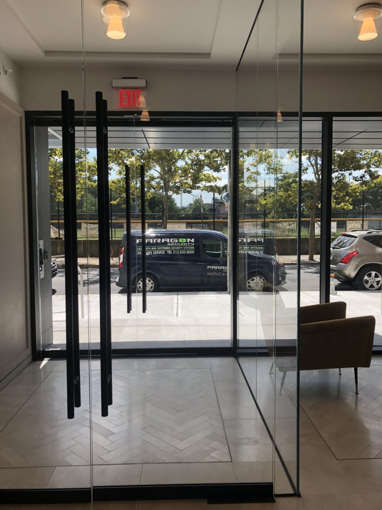 Paragon's installation van seen from inside a set of glass doors