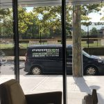 Paragon's installation van seen from inside a glass window