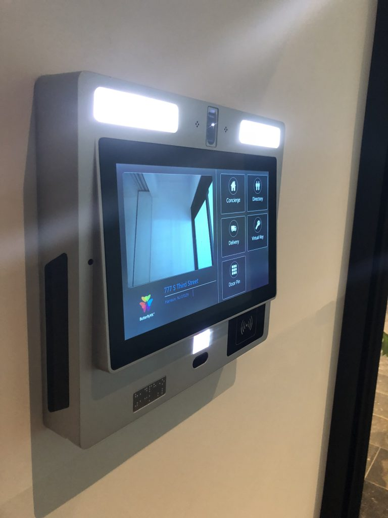 Butterfly intercom touch screen control panel shown installed