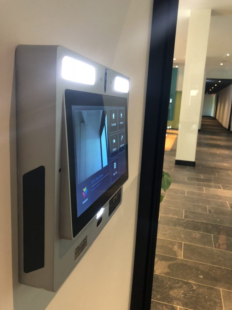 Butterfly intercom touch screen control panel shown installed and from a side view