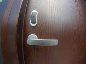 SmartAir lock and door handle shown installed on a wood door