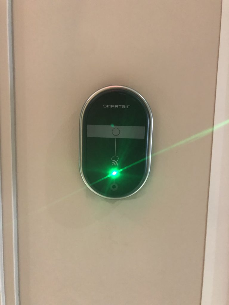 SmartAir lock and door handle shown with green light shining from the unit