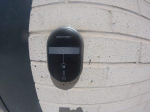 SmartAir lock installed on an exterior brock wall