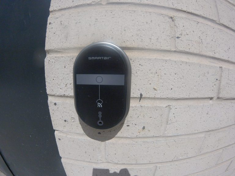 SmartAir lock installed on an exterior brock wall