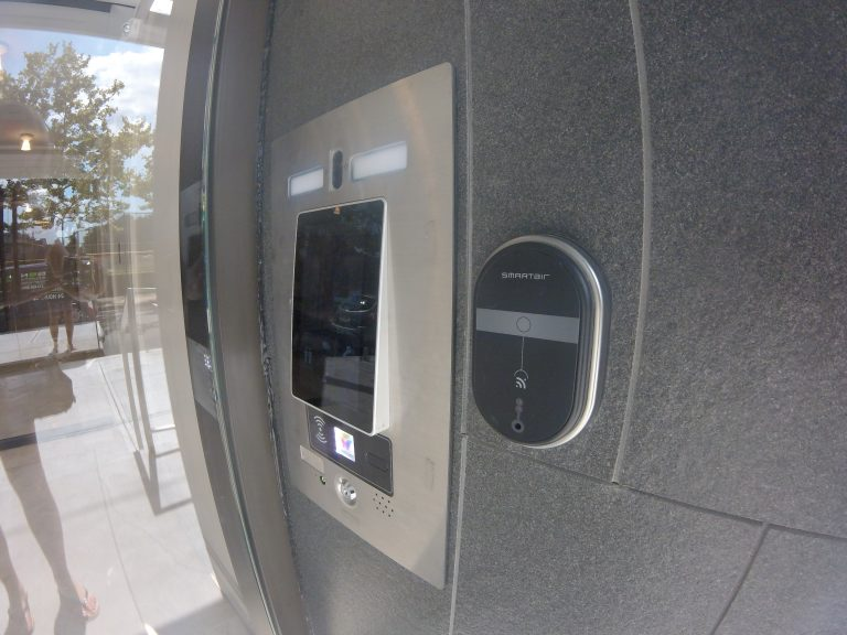 Access control system and smart air lock shown installed on the exterior of a residential entry