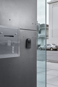 View of latch reader on the exterior door of a multi-unit building